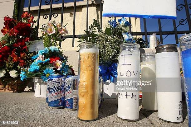 Message of love is written on a memorial of candles, flowers, and beer to a slain suspected gang member who was killed there on January 31, and which...