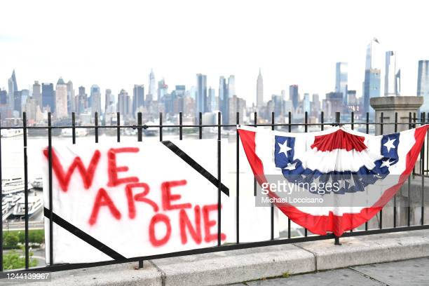 A message of peace and equality in honor of George Floyd hangs on a fence overlooking the Manhattan skyline on Blvd East on June 03 2020 in Weehawken...