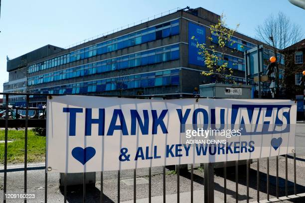 Message of thanks to the NHS is pictured attached to railings outside Watford General Hospital in north west London on April 5 as life in Britain...