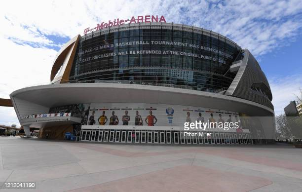 A message on an LED video wall informs fans of the cancellation of the Pac12 Conference men's basketball tournament at TMobile Arena on March 12 2020...