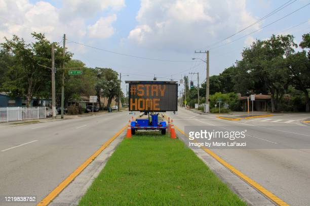 "message on digital road sign ""stay home"" - government shutdown stock pictures, royalty-free photos & images"