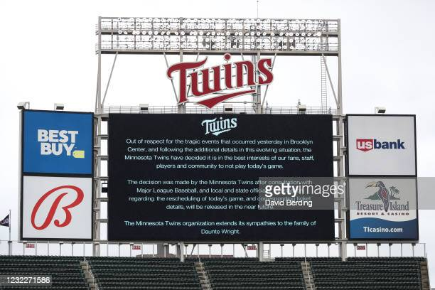Message on the video board displays a game postponement between the Boston Red Sox and Minnesota Twins at Target Field on April 12, 2021 in...