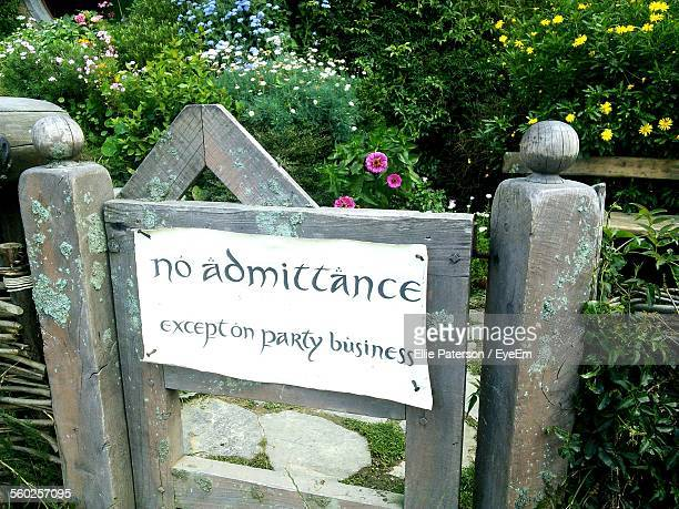 message on wooden gate reading no admittance except on party business - j.r.r. tolkien stock pictures, royalty-free photos & images