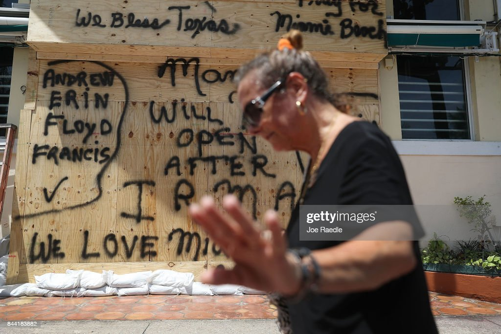 A message reading 'Will open after Irma' is written on plywood being used to cover the windows of a building as people prepare for the arrival of Hurricane Irma on September 8, 2017 in Miami Beach, Florida. Florida appears to be in the path of the Hurricane which may come ashore at category 4.