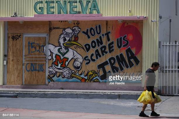 """Message reading """"You Don't Scare Us Irma"""" is written on plywood being used to cover the windows of a building as people prepare for the arrival of..."""