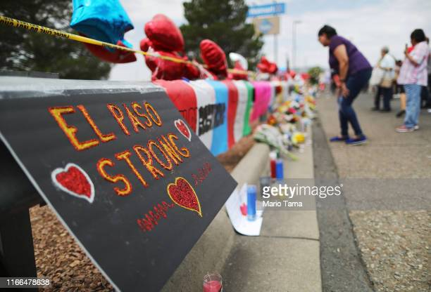 A message reads 'El Paso Strong' at a makeshift memorial honoring victims outside Walmart near the scene of a mass shooting which left at least 22...