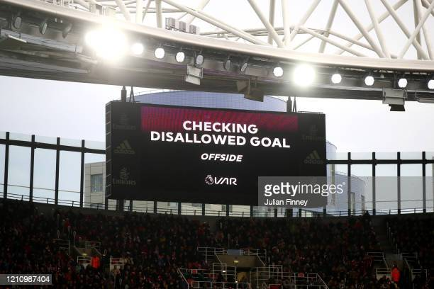 Message regarding a VAR review for disallowed goal is displayed on the LED screen in the stadium during the Premier League match between Arsenal FC...