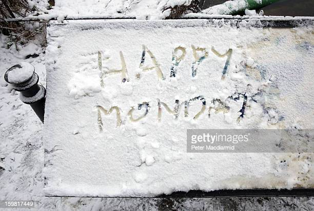 Message relating to Blue Monday which some claim as statistically the most depressing day of the year is written in snow on a sign board in St...