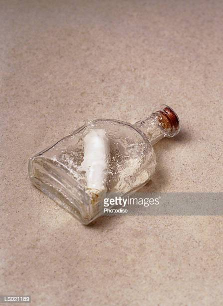 message scrolled in a bottle - scrollen stock pictures, royalty-free photos & images