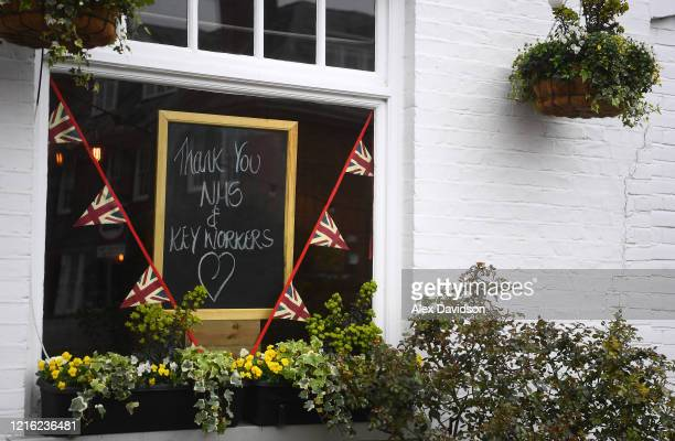 A message thanking workers is displayed at the Swan Pub in Wimbledon on April 01 2020 in London England The Coronavirus pandemic has spread to many...