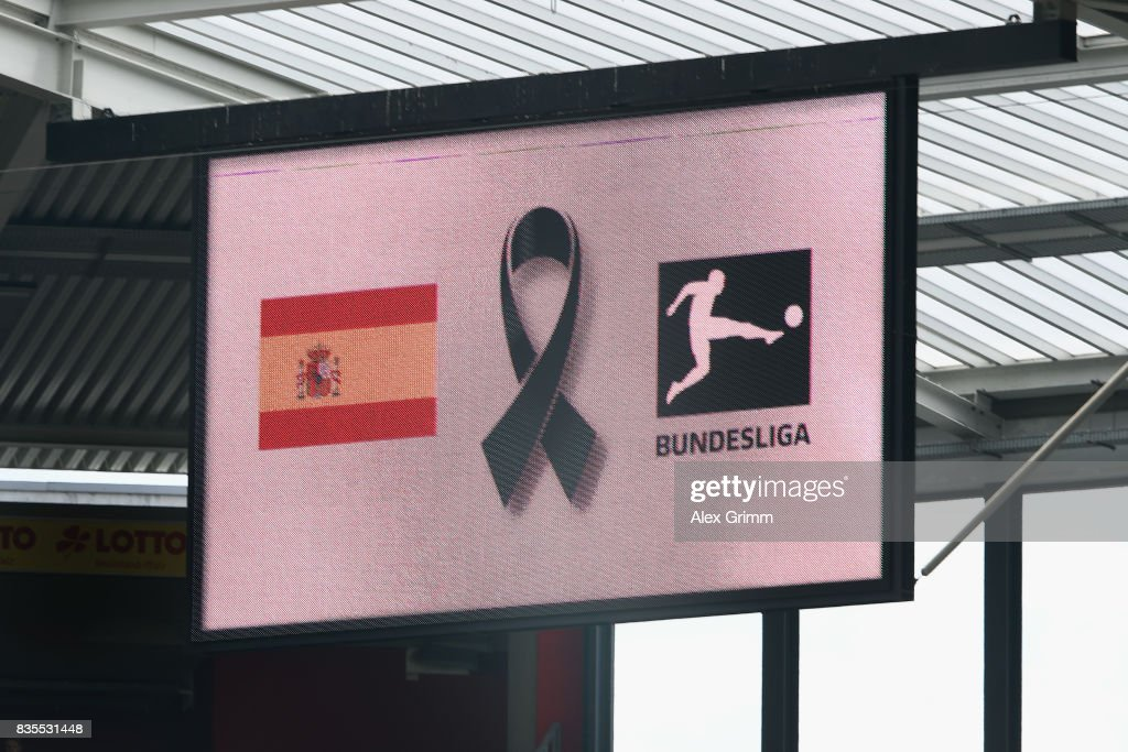 A message to memory the victims of Thursday's terrorist attacks in Spain is seen on the screen during the Bundesliga match between 1. FSV Mainz 05 and Hannover 96 at Opel Arena on August 19, 2017 in Mainz, Germany.