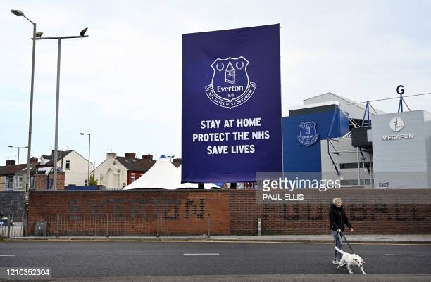 Message urging the public to stay at home during the nationwide lockdown because of the COVID-19 outbreak is seen outside Everton football club's...