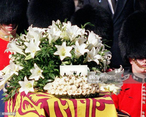 A message where is written 'Mummy' stands on the coffin of Diana Princess of Wales as the gun carriage carrying her remains makes its way to...