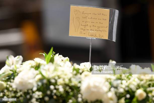 A message written on a floral tribute by Cressida Dick Commissioner of the Metropolitan Police Service is displayed at Southwark Cathedral ahead of...