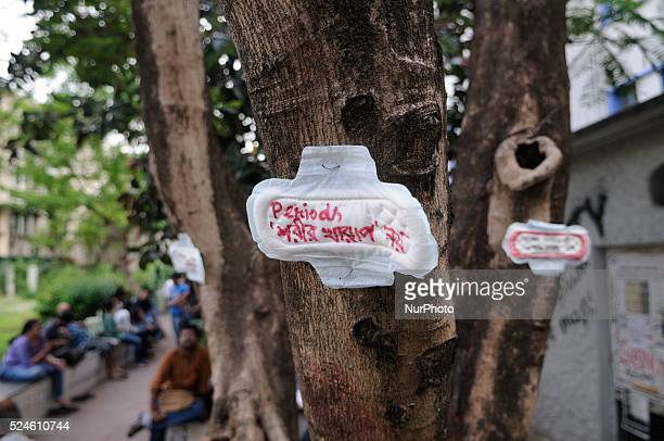 A message written on a sanitary napkin which says quotmenstruation is not an illnessquot during a Sanitary napkin protest in Kolkata India