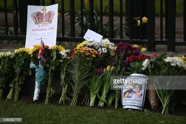 Messages amidst floral tributes include a picture of a Bangladesh postal stamp featuring Britain's Queen Elizabeth II and Britain's Prince Philip,...