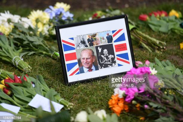 Messages and floral tributes are pictured outside Windsor Castle in Windsor, west of London, on April 13 following the April 9 death of Britain's...