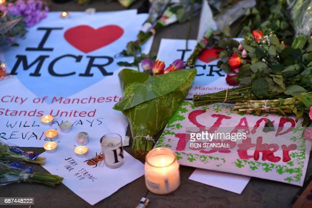 TOPSHOT Messages and floral tributes are seen in Albert Square in Manchester northwest England on May 23 in solidarity with those killed and injured...