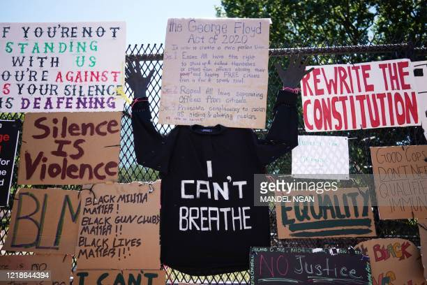 TOPSHOT Messages are attached to the security fence on the north side of Lafayette Square near the White House in Washington DC on June 8 2020 On May...