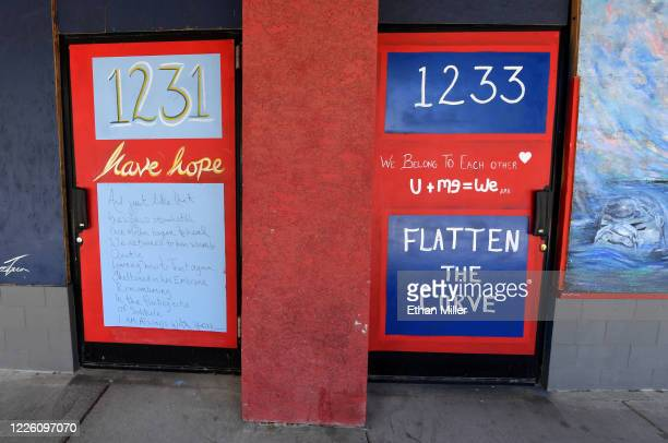 Messages are displayed on doors at Sin City Yoga in the Arts District amid the spread the coronavirus on May 20, 2020 in Las Vegas, Nevada. Some...