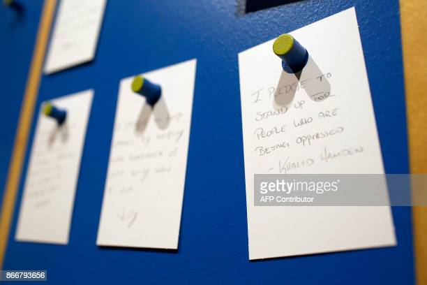 Messages are displayed on the pledge board at the Take A Stand Center at the Illinois Holocaust Museum Education Center on October 26 2017 in Skokie...