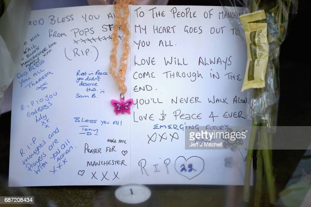 Messages are left amongst tributes by members of the public in St Ann Square on Tuesday May 23 2017 in ManchesterEngland At least 22 people were...