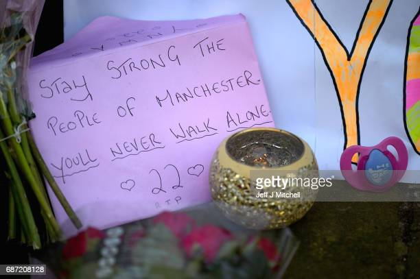 Messages are left amongst tributes left by members of the public in St Ann Square on Tuesday May 23 2017 in ManchesterEngland At least 22 people were...