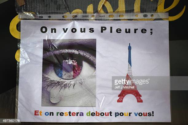 Messages are left on the window of La Belle Equipe cafeon Rue de Charonne following Friday's terrorist attack on November 16 2015 in Paris France...
