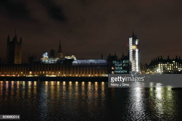 Messages are projected onto the Houses of Parliament to mark the start of International Women's Day on March 8 2018 in London England
