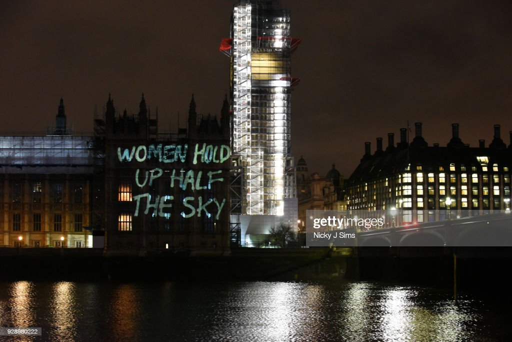 Messages are projected onto the Houses of Parliament to mark the start of International Women's Day on March 8, 2018 in London, England.