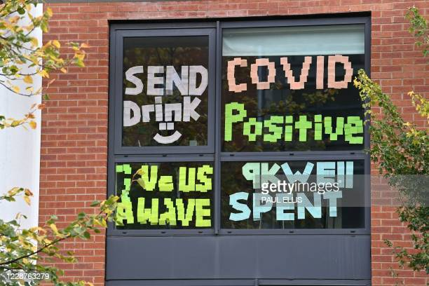Messages are seen, pasted inside the windows of the Oxford Court student accommodation, for students at Manchester Metropolitan University, in...