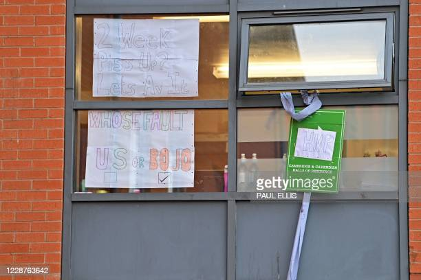 Messages comparing the halls to a prison are seen pasted inside the windows of the Cambridge Halls student accommodation, for students at Manchester...
