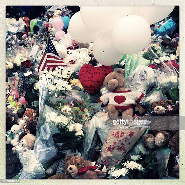Messages flowers and teddy bears left at the shrine set up around the towns Christmas tree in Sandy Hook after the mass shootings at Sandy Hook...