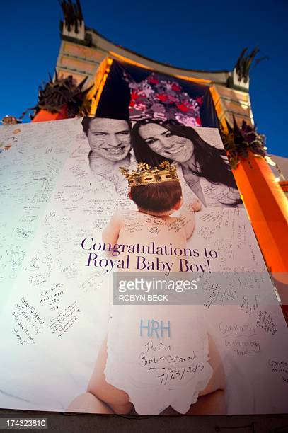 Messages from visitors and tourists are seen on a giant card to Britain's Prince William and Kate the Duchess of Cambridge congratulating the royal...