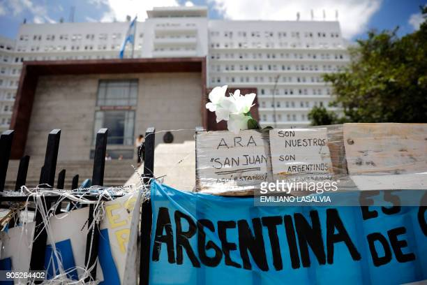 Messages giving strength to the missing submarine crew are seen outside Argentine Navy headquarters in Buenos Aires where Argentine Navy spokesman...