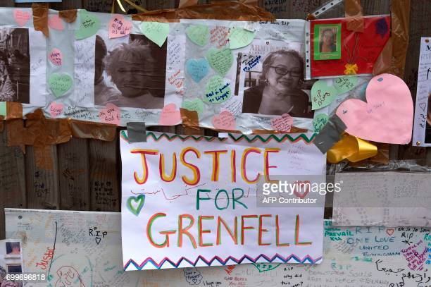 Messages left by wellwishers in tribute to the victims of the June 14 Grenfell Tower block fire are pictured near the scene of the fire in North...