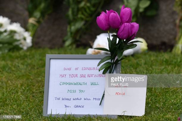 Messages of condolence accompany floral tributes laid in honour of Britain's Prince Philip, Duke of Edinburgh outside Windsor Castle in Windsor, west...
