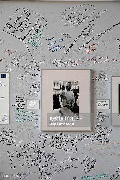 Messages of honor and support are written on the wall around a photograph of former South African President Nelson Mandela at Regina Mundi Catholic...