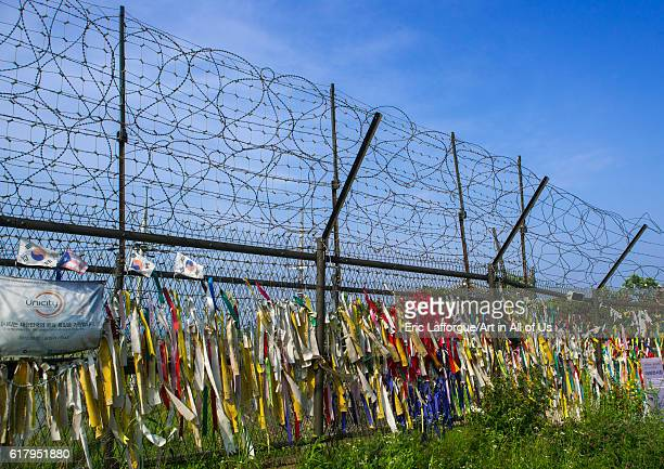 Messages of peace and unity written on ribbons left on fence at dmz sudogwon paju South Korea on May 31 2016 in Paju South Korea