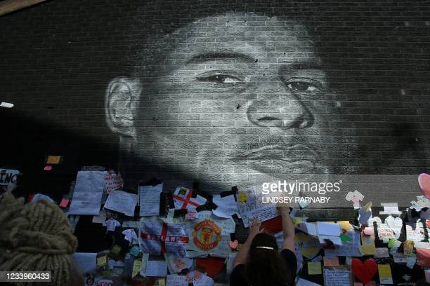 Messages of support adorn a mural of England forward Marcus Rashford after it was defaced on July 13, 2021 in Manchester, northwest England. - The...