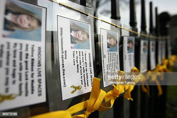 Messages of support and yellow ribbons hang from a fence in the village centre of Rothley the home town of the McCann family on the first anniversary...