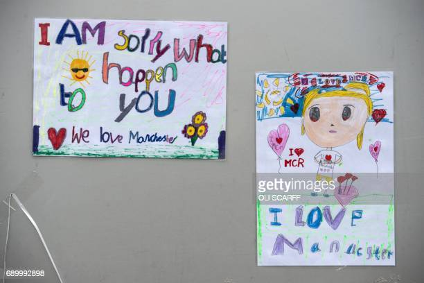 Messages of support are pictured outside Victoria Station car park near to the Manchester Arena in Manchester northwest England on May 30 placed in...