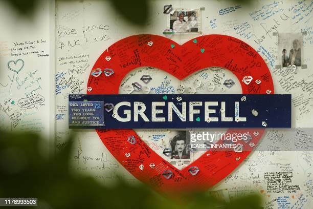 TOPSHOT Messages of support are written on a wall surrounding Grenfell tower in west London on October 30 2019 The emergency response to a 2017...