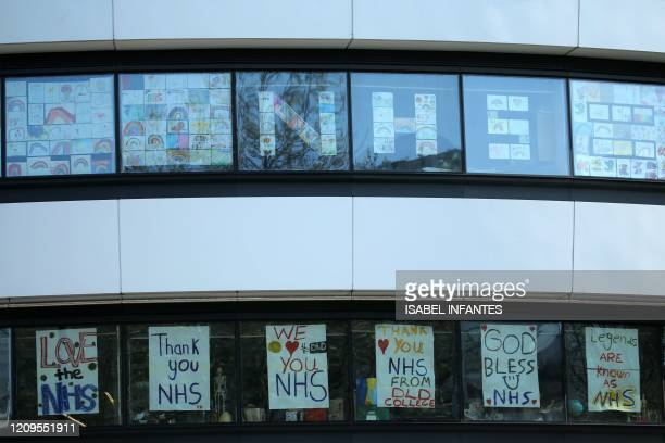 Messages of support for the NHS are seen in windows of a building close to St Thomas' Hospital in central London on April 9 where Britain's prime...