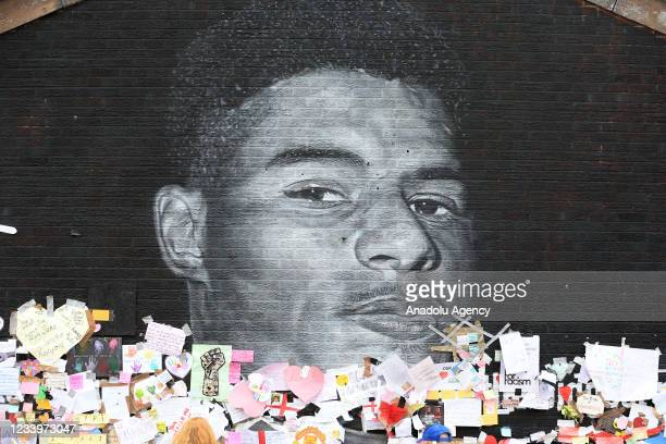 Messages of support left by well-wishers at a mural of British footballer Marcus Rashford in his hometown of Withington in Manchester, north west...