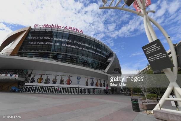 Messages on an LED video wall and a digital sign inform fans of the cancellation of the Pac-12 Conference men's basketball tournament at T-Mobile...