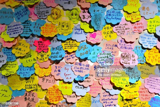 Messages to commemorate the victims of the arson of Kyoto Animation studio are put at a message board in Akihabara district on July 25 2019 in Tokyo...
