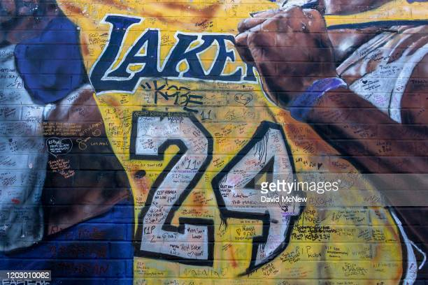 Messages written by fans are seen on a mural for former Los Angeles Lakers basketball star Kobe Bryant during the official memorial ceremony for him...