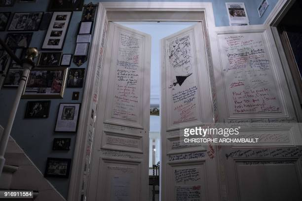 Messages written by friends of the late French writer Gonzague SaintBris adorn a set of doors in his flat in Paris on January 22 2018 / AFP PHOTO /...