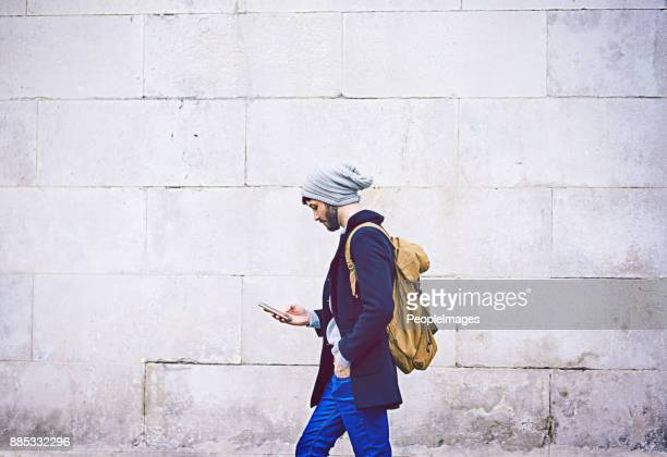 messaging on the move - gray hat stock pictures, royalty-free photos & images
